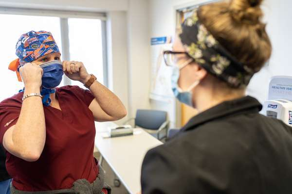 Brenda Mortimer, RN, is fit tested for a N95 mask by Melissa Benyi, RN.