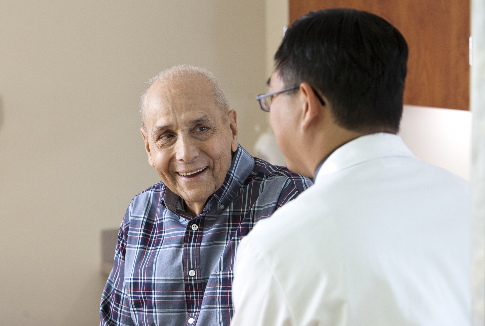 Dr. Tsu speaks with a patient