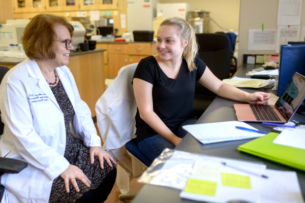 Dr. Avram works on research with a colleague