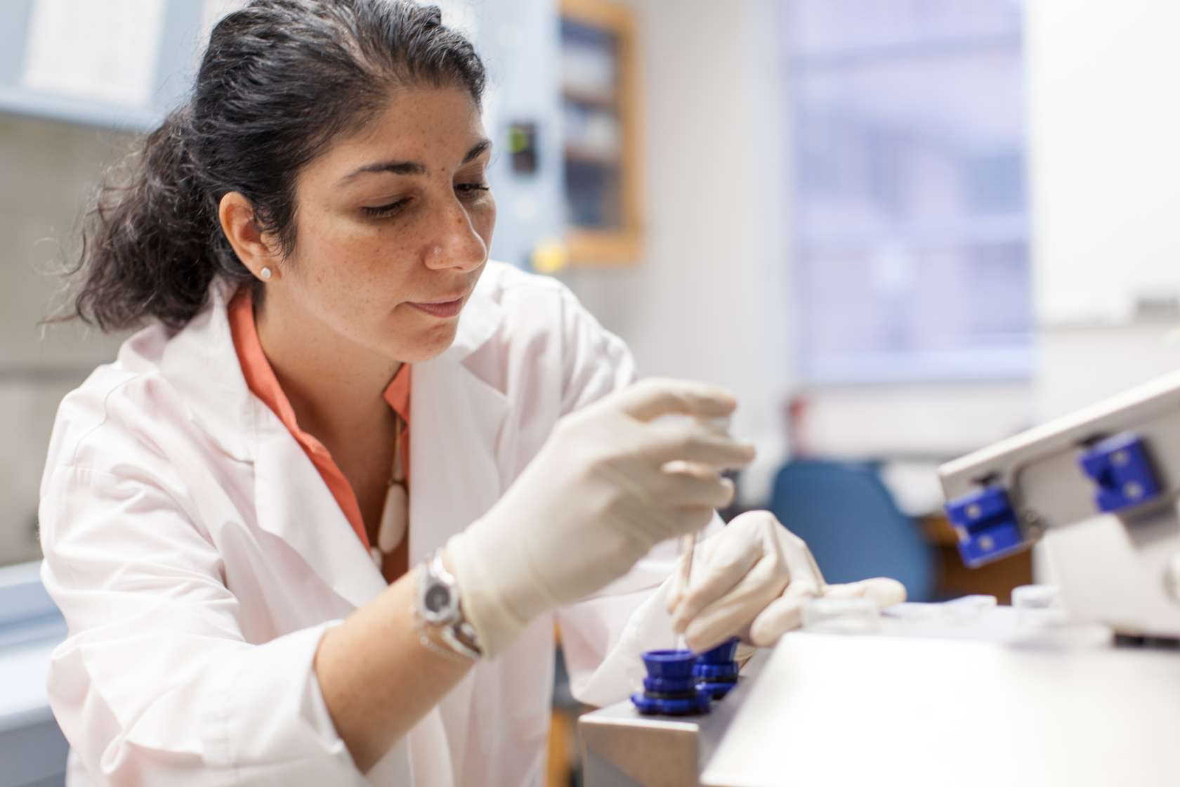 A researcher uses a pipette